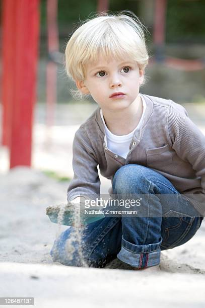 Blond boy playing on playground