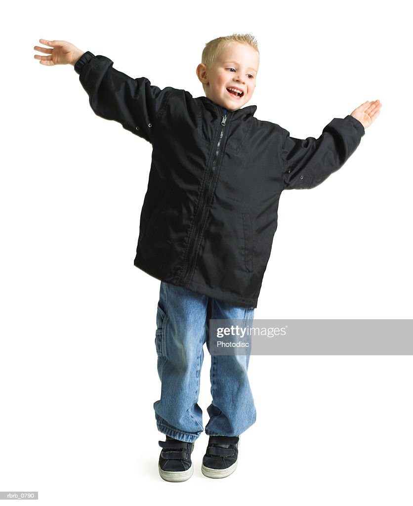 blond caucasian boy jumping and similing with arms outstreached : Stockfoto