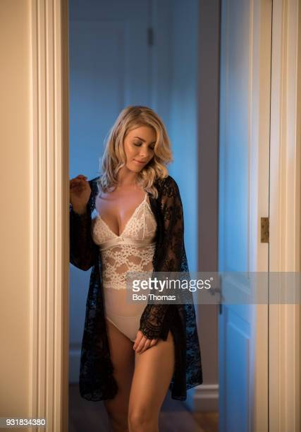 blond caucasian woman wearing a nightie, standing at a bedroom doorway - women in slips stock pictures, royalty-free photos & images