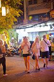 blond caucasian women tourists are walking