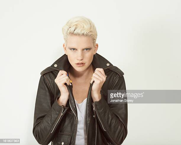 blond female turning up the collar of jacket - leather stock pictures, royalty-free photos & images