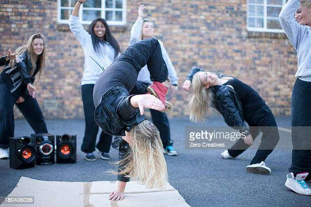 blond girl breakdancing in playground - breakdancing stock photos and pictures