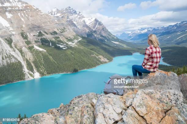 Blond girl contemplating Peyto lake, Canada