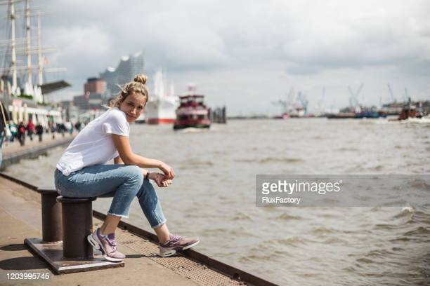 blond girl enjoying fresh air - hamburg germany stock pictures, royalty-free photos & images
