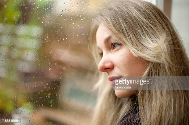 Blond girl looking far away