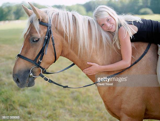 blond girl on horse - hairy little girls stock photos and pictures