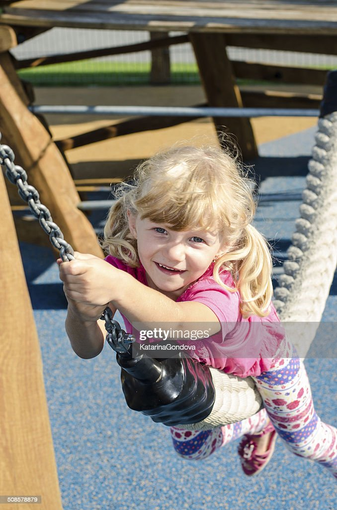 blond girl on playground : Stock Photo