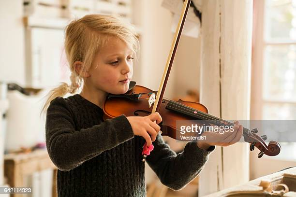 blond girl playing violin - violin stock pictures, royalty-free photos & images