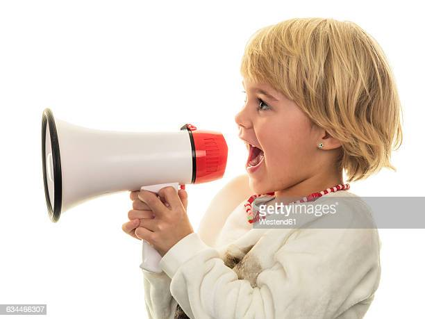 Blond girl shouting in megaphone