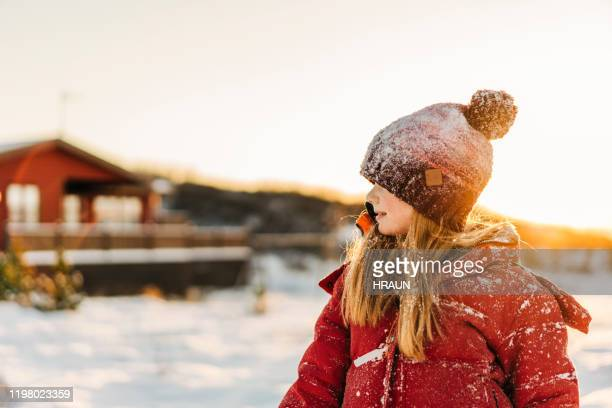 blond girl standing outdoors during winter - coat stock pictures, royalty-free photos & images