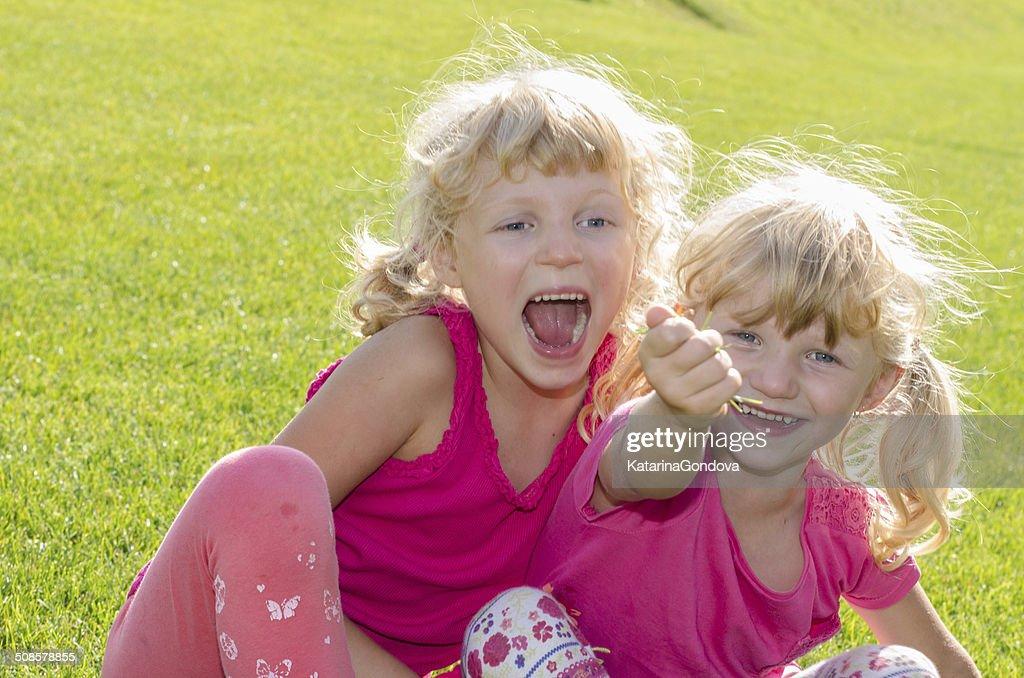 blond girls on grass : Stock Photo