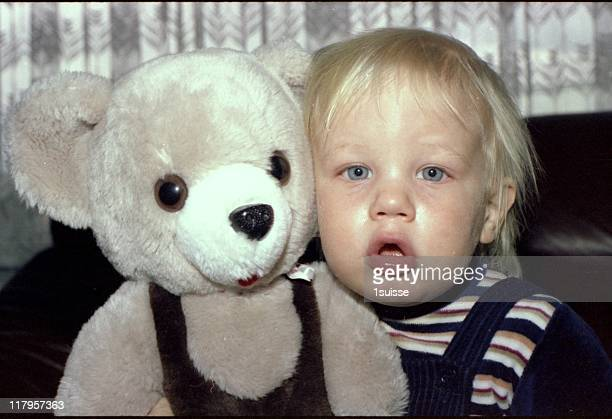 Blond hair boy and teddy bear