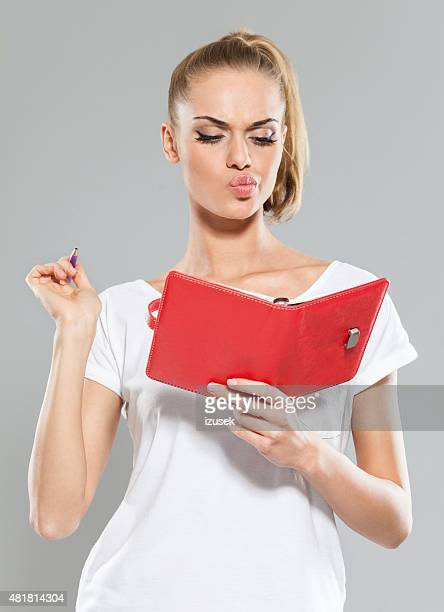 Blond hair young woman holding organizer