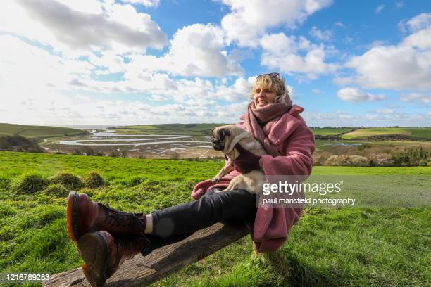 "blond lady and pug - ""paul mansfield photography"" stock pictures, royalty-free photos & images"
