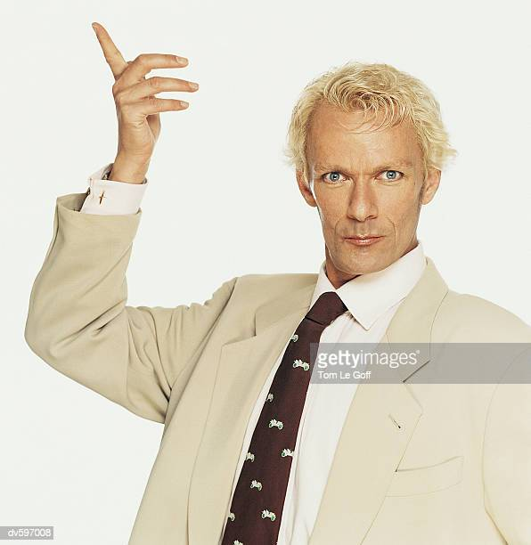 blond man wearing a beige suit - bleached hair stock photos and pictures