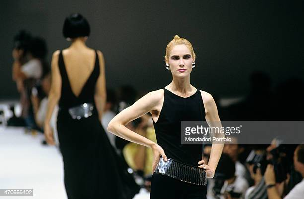 'A blond model wears a black dress by Basile during a fashion show Milan 1986 '