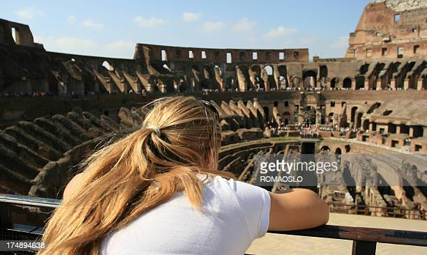Blond tourist in Coliseum, Rome Italy
