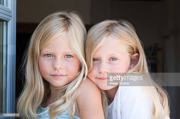 blond twin girls, portrait - identical twin stock pictures, royalty-free photos & images