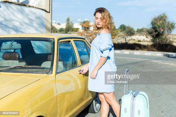 Blond woman and yellow car