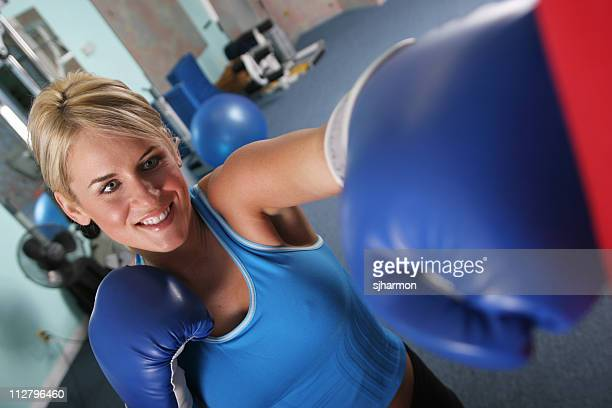 Blond Woman boxing punching exercising perspectice shot