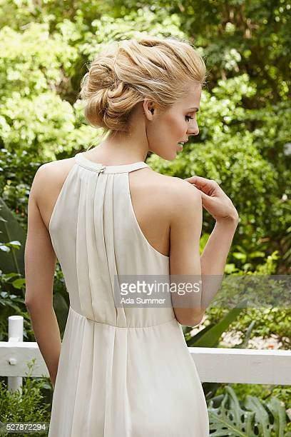 blond woman in a white dress - white dress stock pictures, royalty-free photos & images