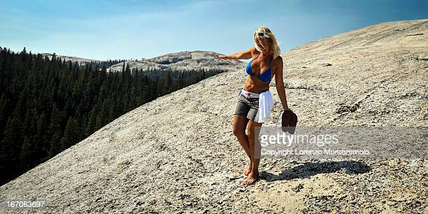 Blond woman in bikini in scenic location