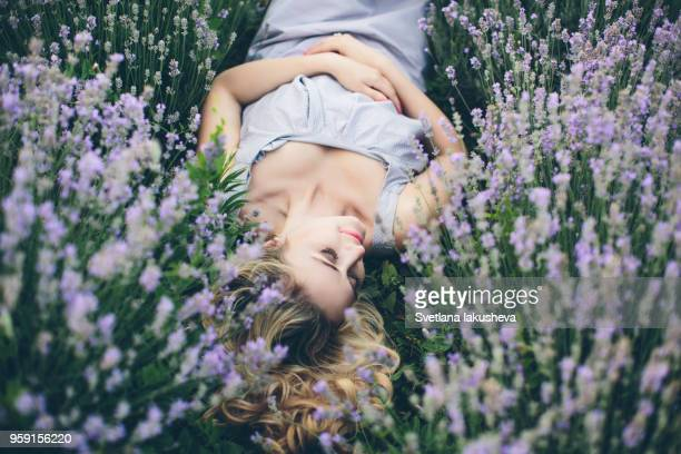 blond woman in light purple dress posing on lavender - purple dress stock pictures, royalty-free photos & images