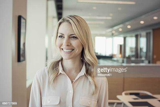 Blond woman in office, portait