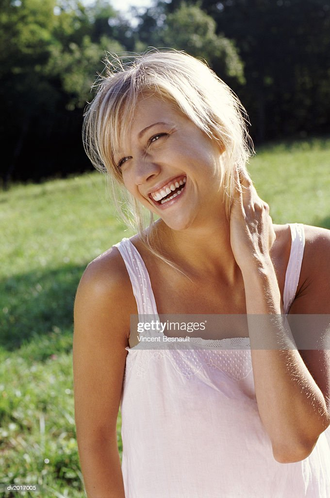 Blond Woman Laughing in a Park : Stock Photo