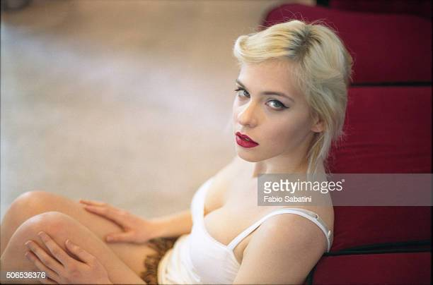 Blond woman on red couch