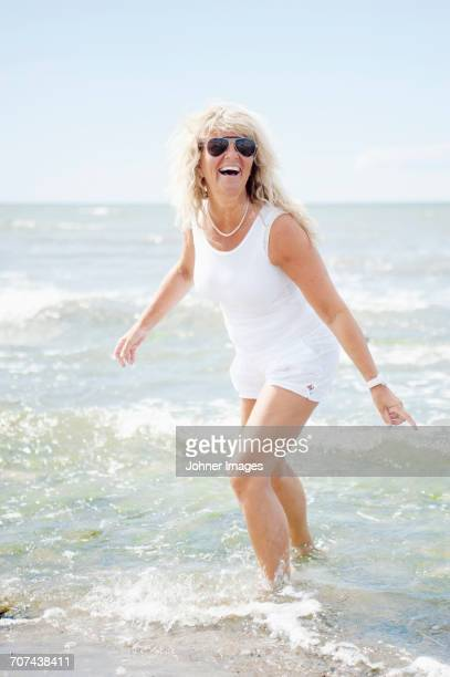 Blond woman playing on beach