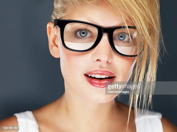 Blond woman wearing glasses and glossy lipstick