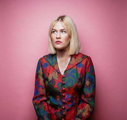 Blond woman wearing multi-colored coat - gettyimageskorea