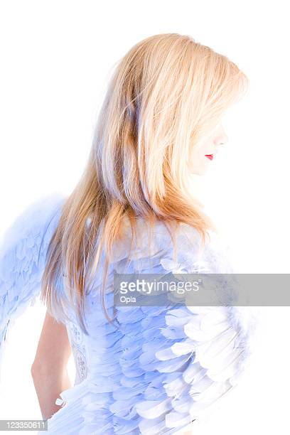 blond woman with angel wings - animal body part stock pictures, royalty-free photos & images