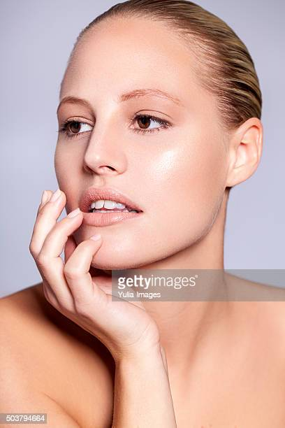 Blond Woman with Hand on Chin Looking to Side