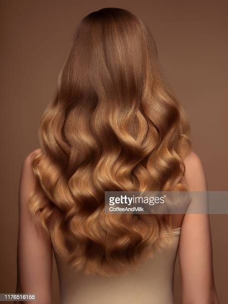 blond woman with long and shiny hair - curly stock pictures, royalty-free photos & images