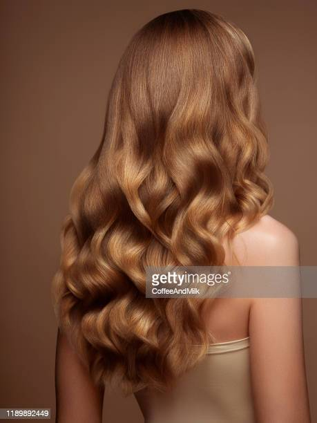 blond woman with long and shiny hair - hair back stock pictures, royalty-free photos & images