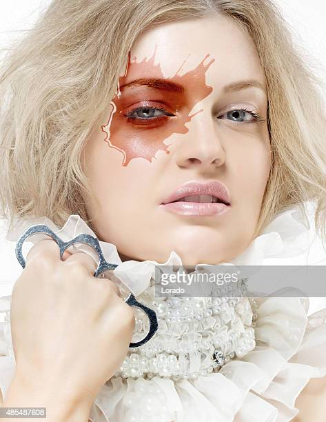 blond woman with pearls jewellery and knuckle duster