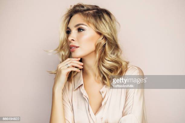 blond woman with perfect skin - stage make up stock photos and pictures