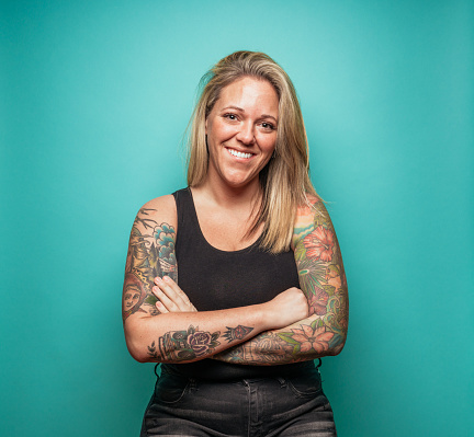 Blond Woman with Tattoos on blue background - gettyimageskorea
