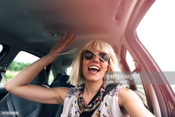 blond young woman in a road trip - fast fashion stock pictures, royalty-free photos & images