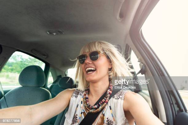 Blond young woman in a road trip