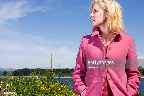 Blond Young Woman in Field with Sunny Sky, Copy Space
