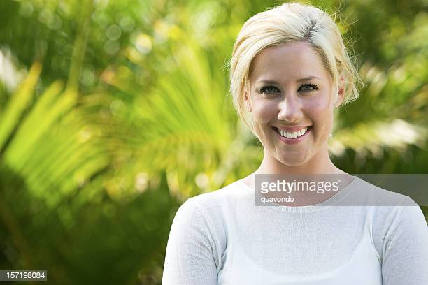 Blond Young Woman Portrait in Tropical Outside Location, Copy Space