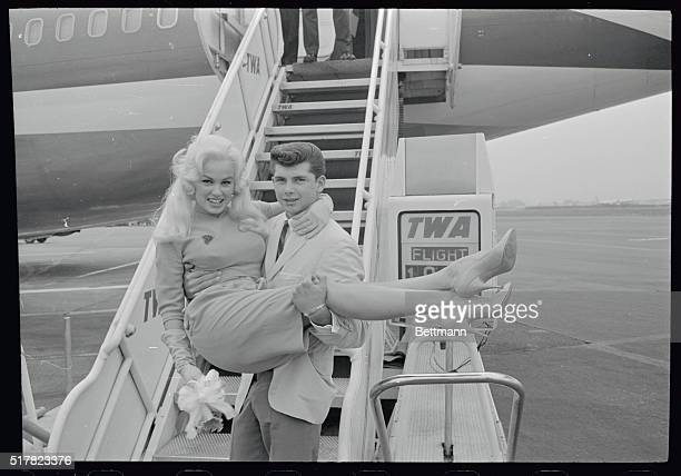 Blonde actress Mamie Von Doren and her 21 year old boyfriend Anthony Santoro of Hollywood are shown at the International Airport before Mamie boarded...