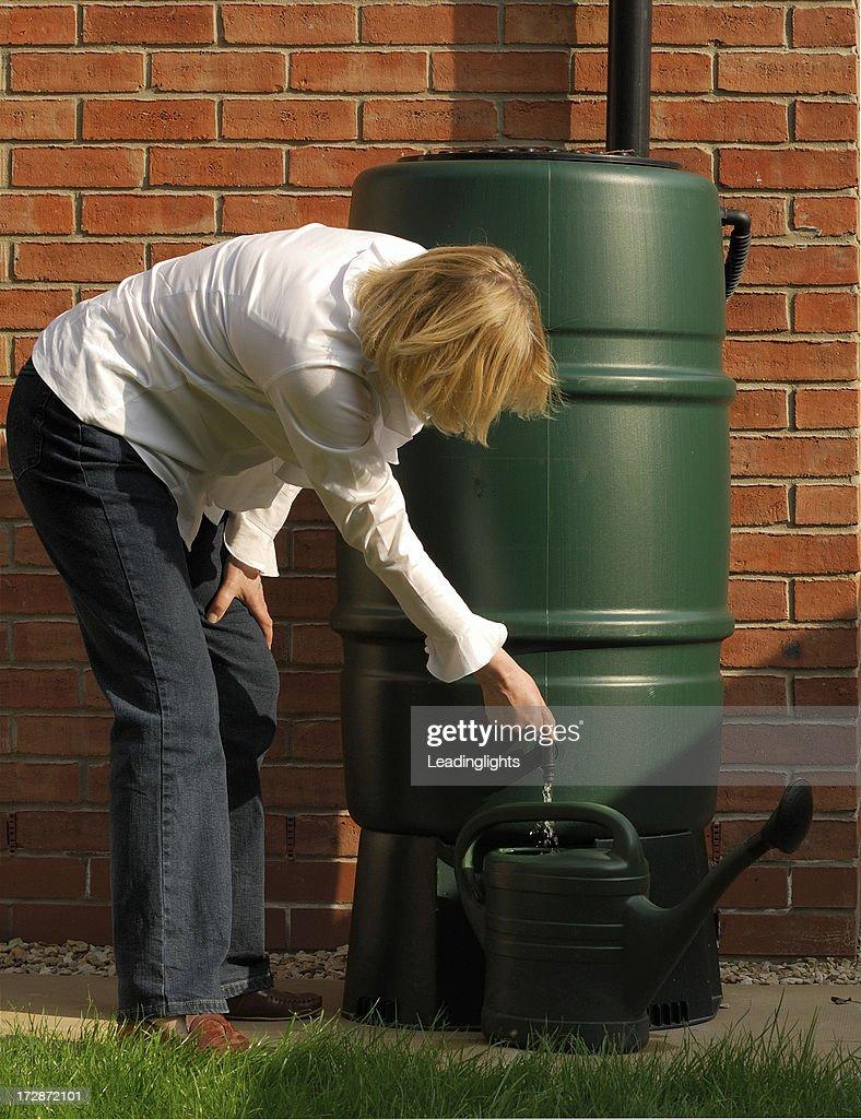 Blonde & Water Butt : Stock Photo