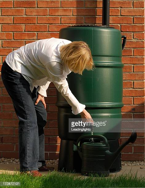 blonde & water butt - storage tank stock photos and pictures