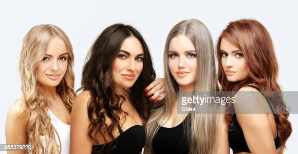 blonde and brunette.concept coloring hair - colouring stock photos and pictures