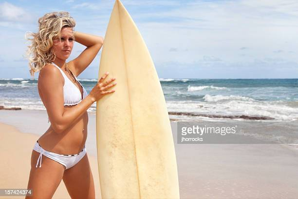 blonde beach babe with surf board - legs spread woman stock photos and pictures