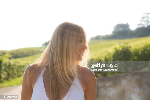 blonde beautiful woman waving her hair against the sun - erwachsener über 30 stock-fotos und bilder